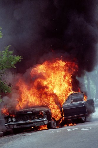 Photo: Joao Wainer © / 04.05.2002 / Old car burning spontaneously in the streets of Jardim Angela, district of Sao Paulo with the highest tax of homicide in town..